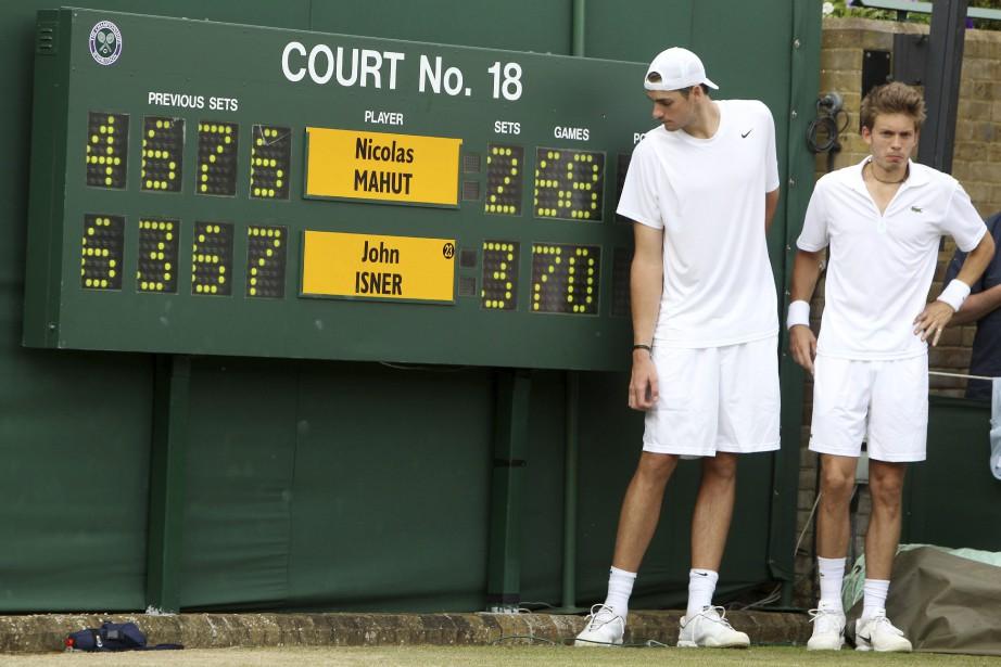 En 2010, John Isner et Nicolas Mahut ont... (Photo Alastair Grant, archives Associated Press)