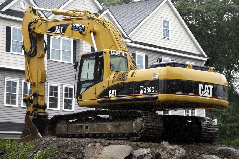L'action du fabricant d'engins de chantier et de... (Photo Elise Amendola, AP)