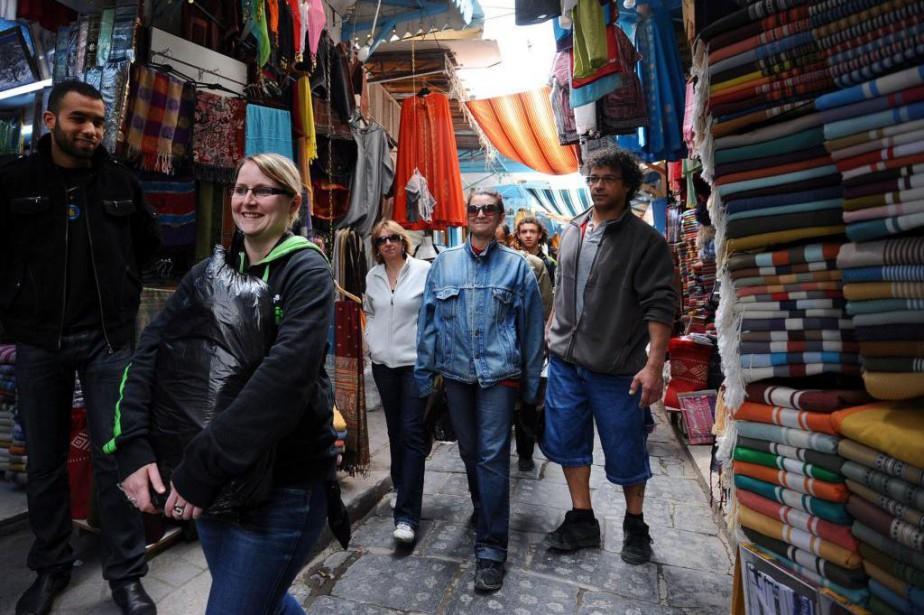 Un souk à Tunis. S'il y a bien... (PHOTO FETHI BELAID, ARCHIVES AGENCE FRANCE-PRESSE)