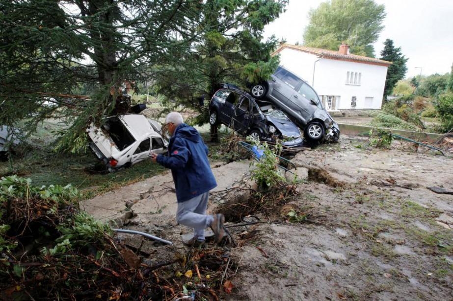La pluie torrentielle a fait de nombreux dégâts... (PhotoJean-Paul Pelissier, Reuters)