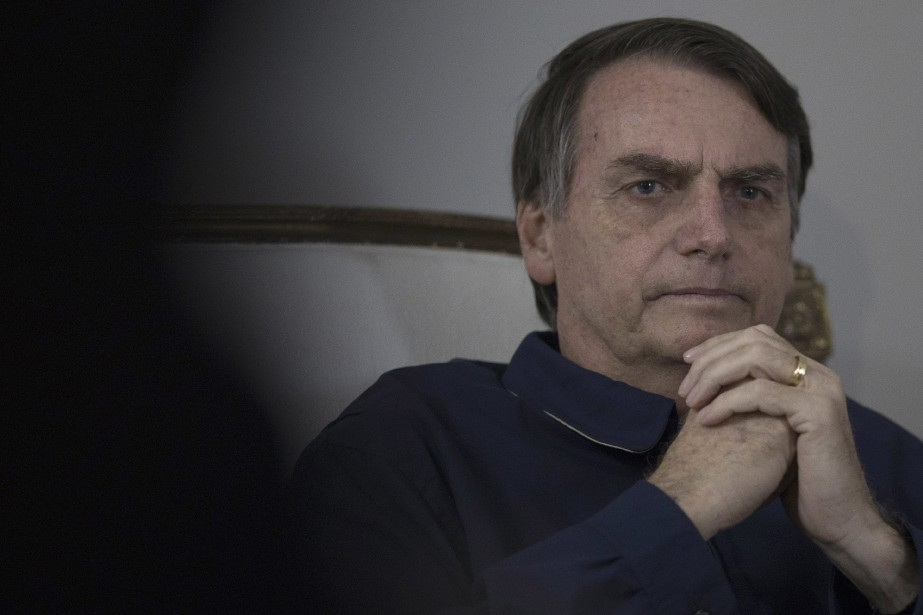 Jair Bolsonaro (photo) a clairement l'intention de s'aligner... (Photo Leo Correa, Associated Press)