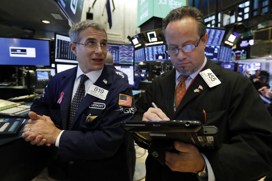 Le Dow Jones prenait 0,58% et le NASDAQ... (Photo Richard Drew, AP)