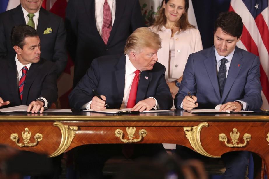 Le nouvel accord de libre-échange a été signé... (PHOTO AP)