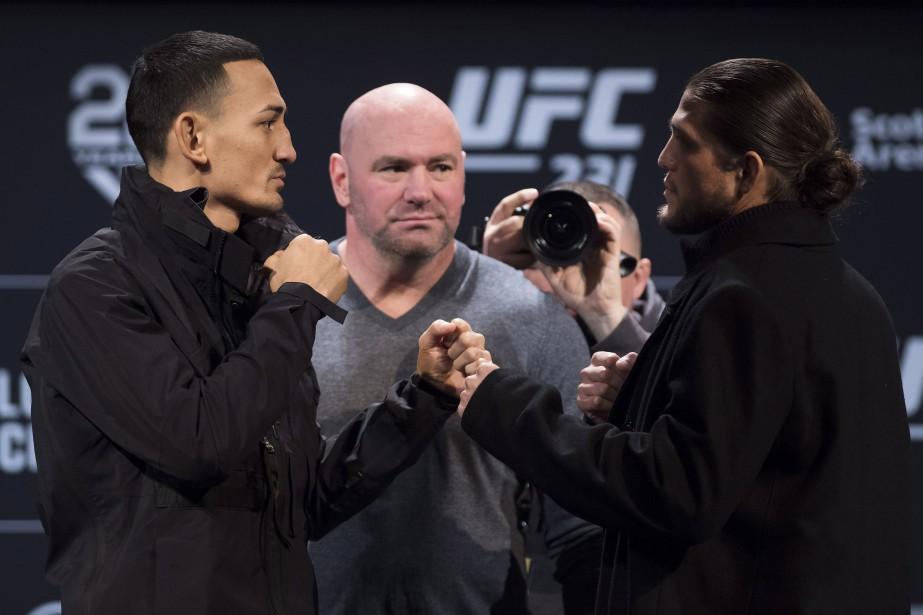 Max Holloway (à gauche) a enregistré un poids... (Photo Nathan Denette, La Presse canadienne)