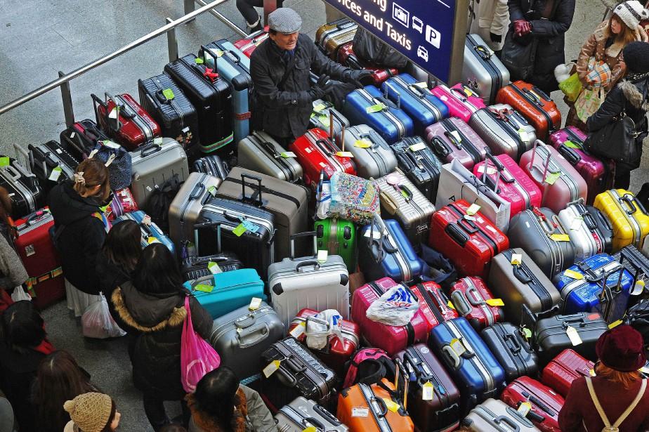 Il est possible de transporter des appareils électroniques... (Photo CARL DE SOUZA, archives AFP)