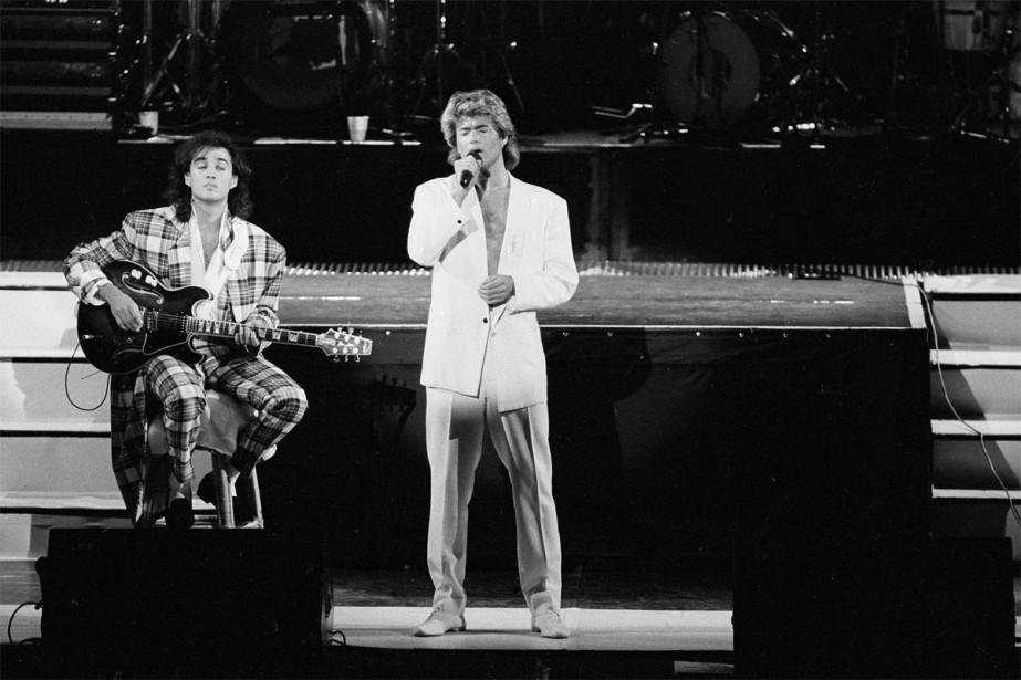 George Michael et Andrew Ridgeley du groupe WHAM!... (Photo archives Associated Press)