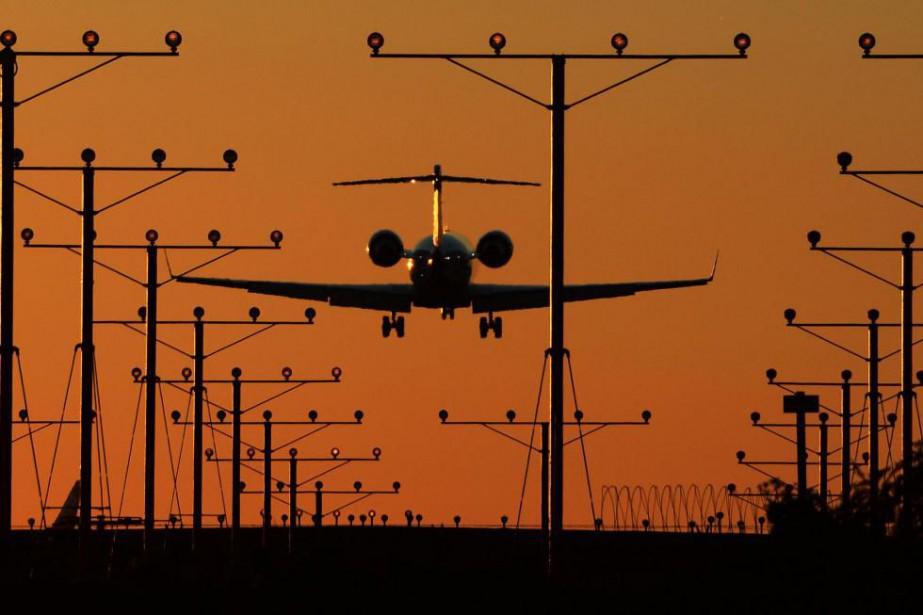 Voyager en avion, malheureusement, c'est très polluant.... (Photo Robyn Beck, archives Agence France-Presse)