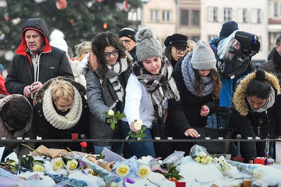 La population s'est réunie à la Place Kleber... (Photo SÉBASTIEN BOZON, Agence France-Presse)