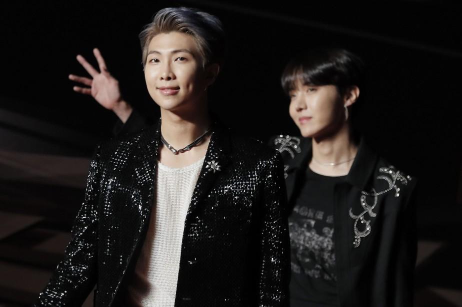 Les membres du groupe BTS lors des Asian... (Photo Kin Cheung, AP)