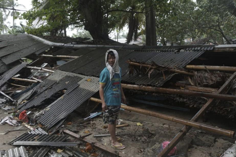 Plus de 60 personnes ont été tuées et des... (Photo Dian Triyuli Handoko, AP)