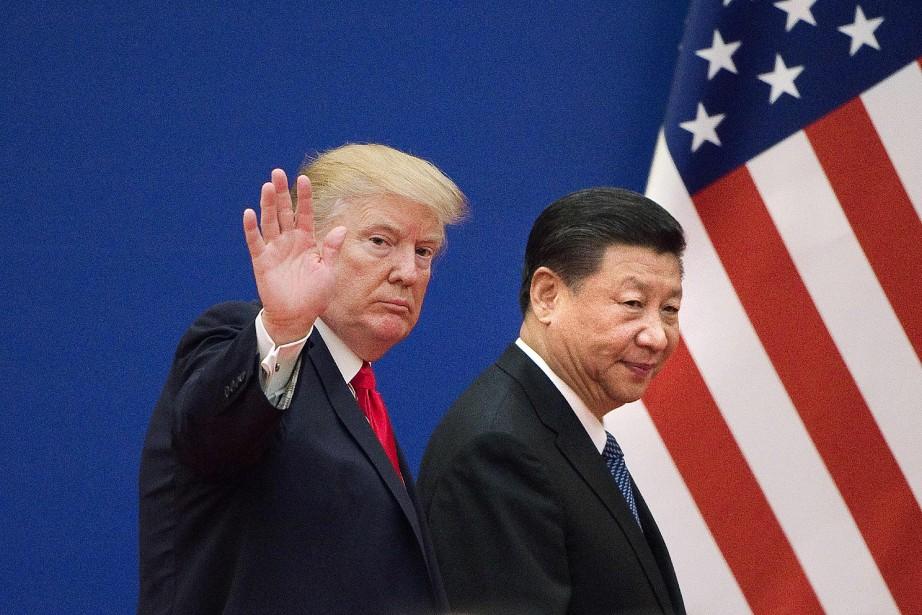 Le président américain DonaldTrump aux côtés de son... (Photo NICOLASASFOURI, AFP)