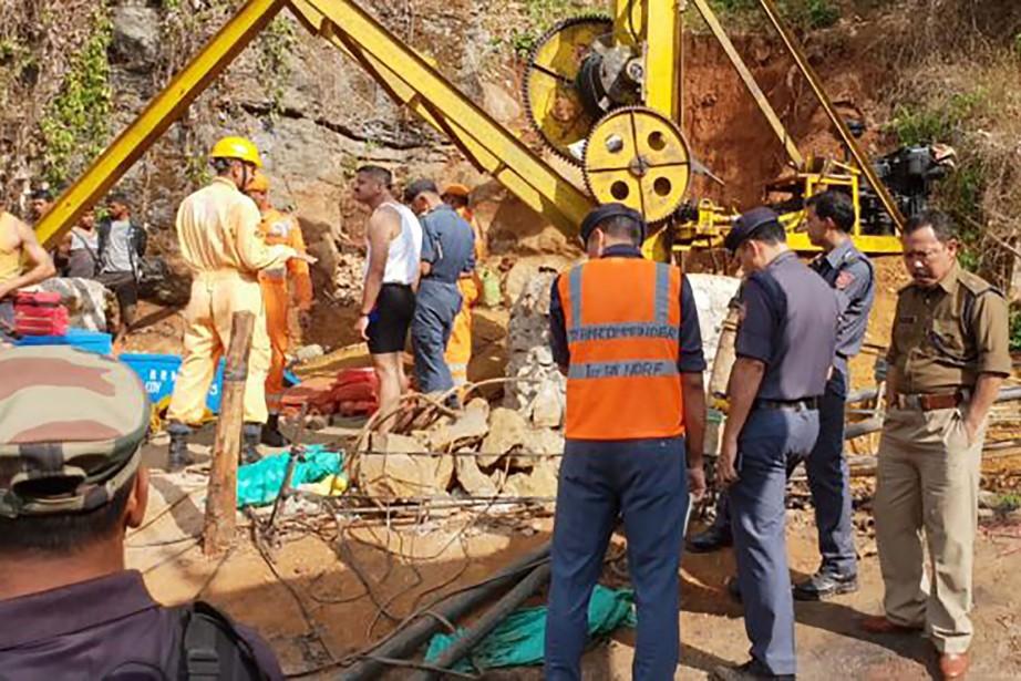 Les ouvriers sont coincés depuis que l'eau d'une... (Photo AFP)