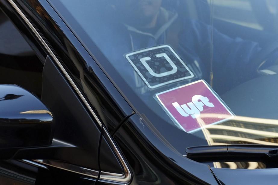 La plateforme de véhicules avec chauffeur Lyft a... (Photo Richard Vogel, archives AP)
