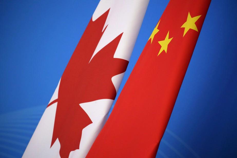 Un total de 13 Canadiens ont été arrêtés... (PHOTO AP)