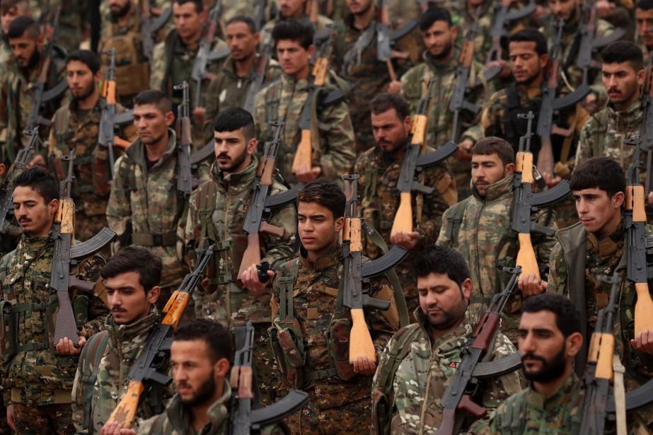 Combattants des forces démocratiques syriennes... (Photo DELIL SOULEIMAN, archives AFP)