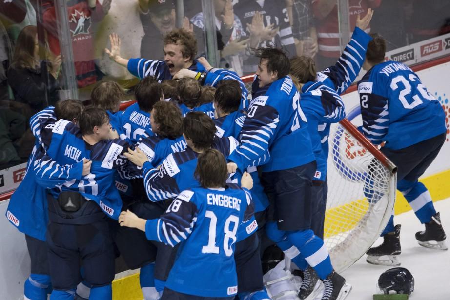 La Finlande a remporté la finale du Championnat... (Photo JONATHAN HAYWARD, la presse canadienne)
