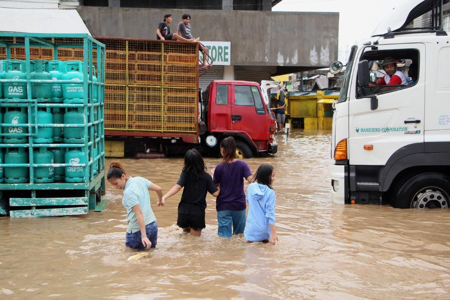La zone touchée est habituée aux typhons, et... (Photo SIMVALE SAYAT, archives AFP)