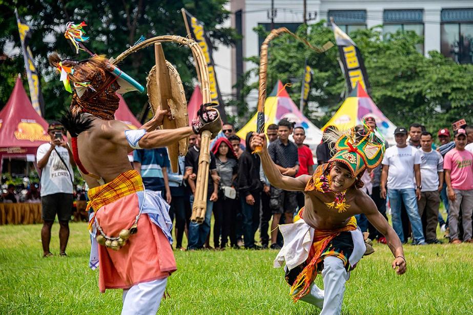Le Caci est un art martial pratiqué par... (Photo JUNI KRISWANTO, Agence France-Presse)