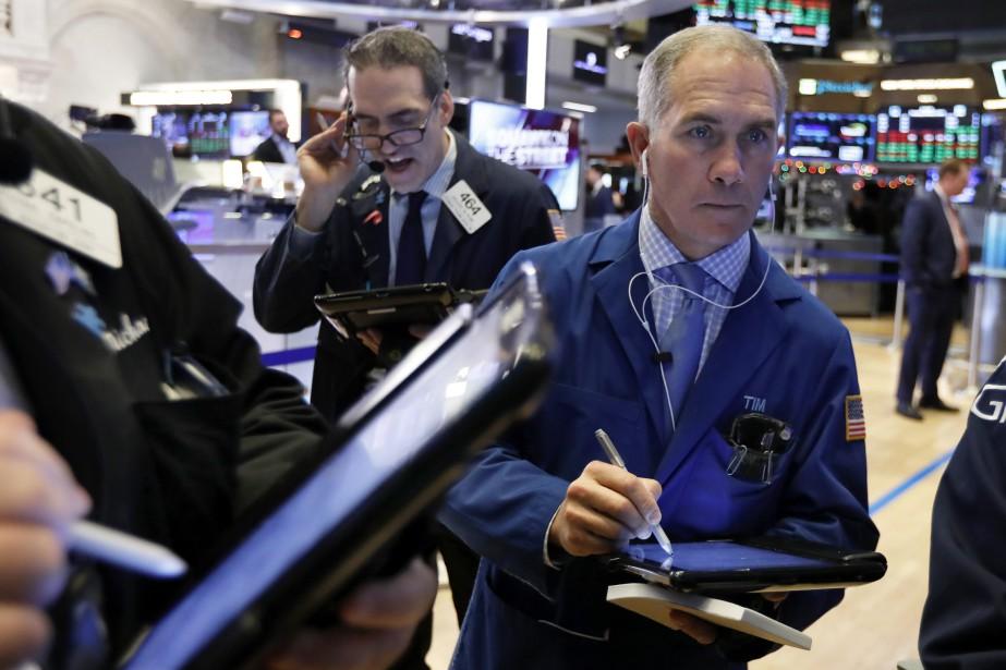 Mardi, «le marché attend des informations positives sur... (Photo Richard Drew, AP)