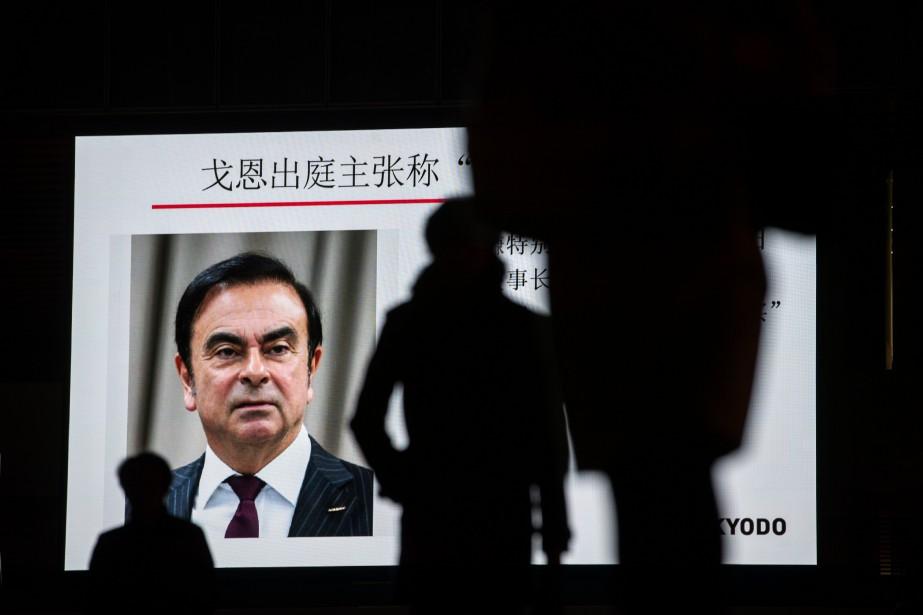Les médias japonais ont couvert la courte audience... (Photo BEHROUZ MEHRI, AFP)