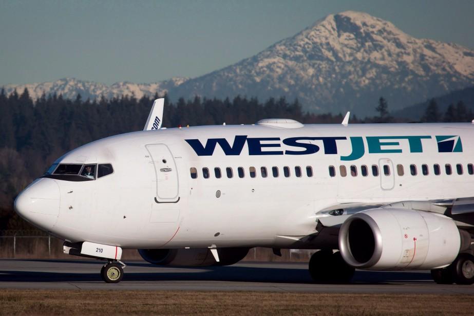 WestJet Airlines a présenté ses excuses, mercredi, à des passagers... (PHOTO PC)