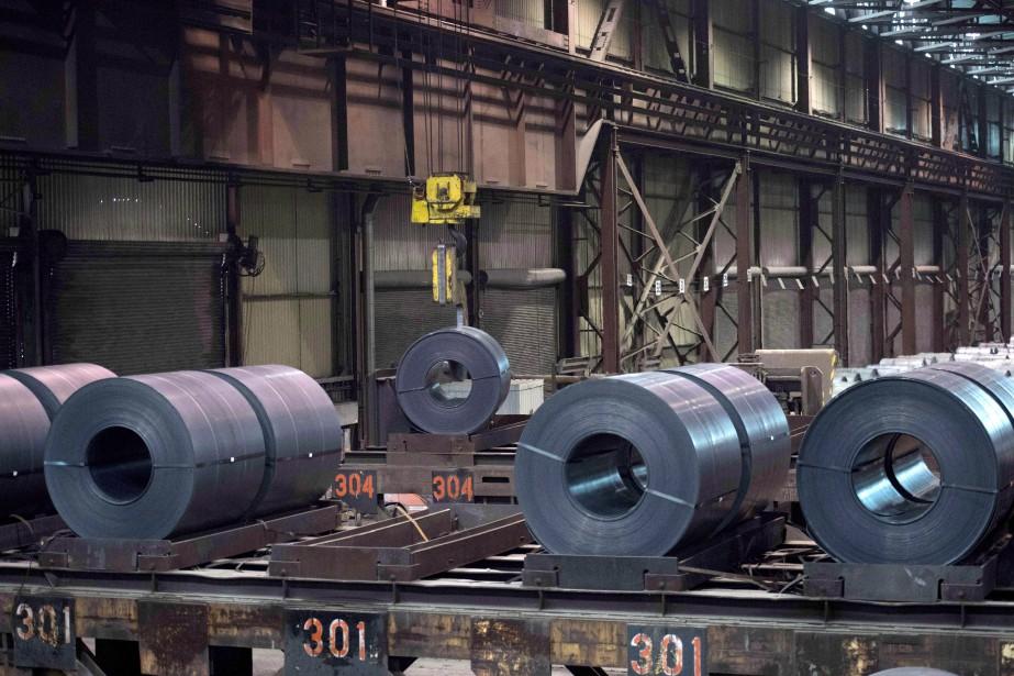 Les producteurs canadiens d'acier et d'aluminium font face... (Photo Justin Tang, archives la presse canadienne)