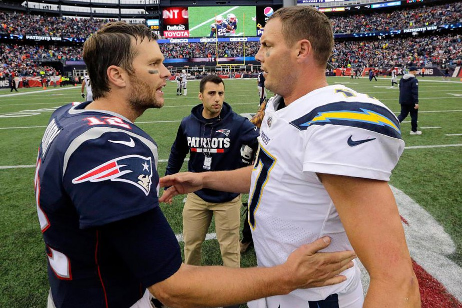 Tom Brady et Philip Rivers... (Photo Steven Senne, Associated Press)