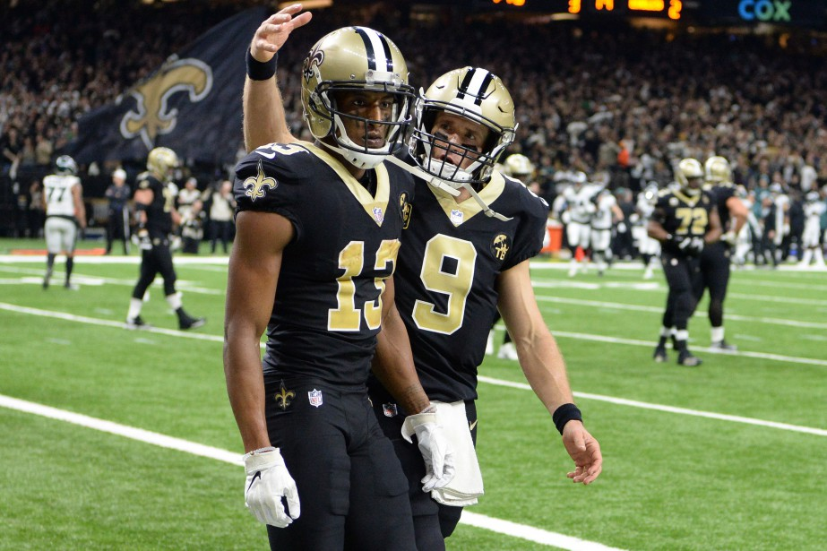 Michael Thomas (13) a célébré avec Drew Brees... (Photo John David Mercer, USA TODAY Sports)