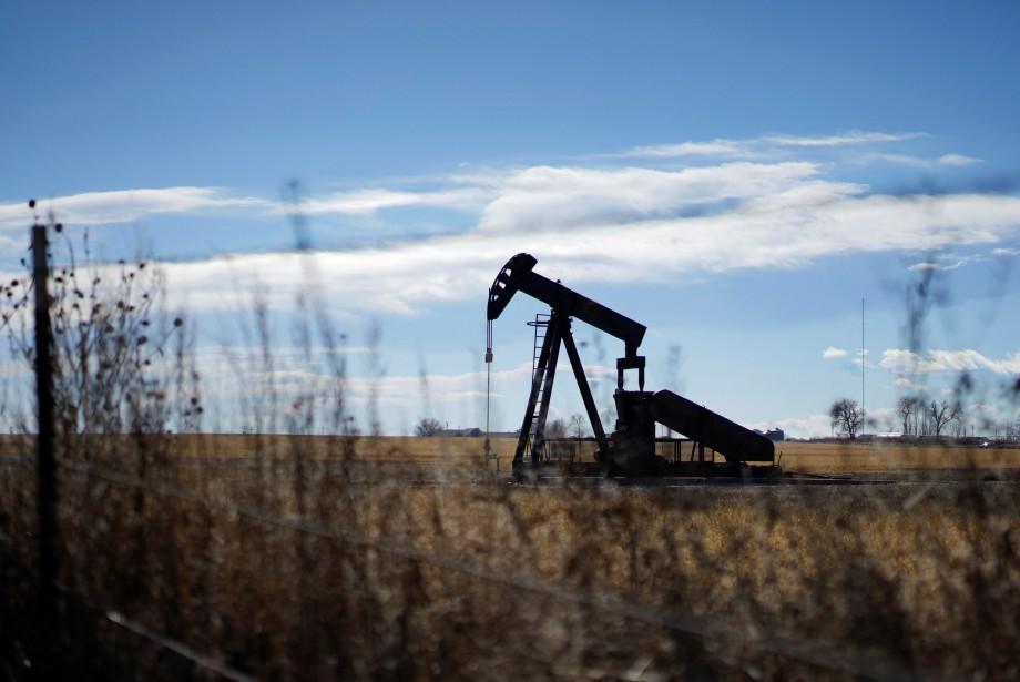 Les cours du pétrole ont terminé en baisse... (Photo Rick Wilking, REUTERS)