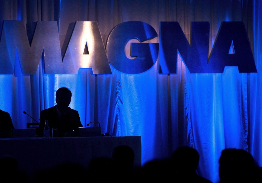 The Magna International Inc. logo is seen prior... (Photo Nathan Denette, THE CANADIAN PRESS)
