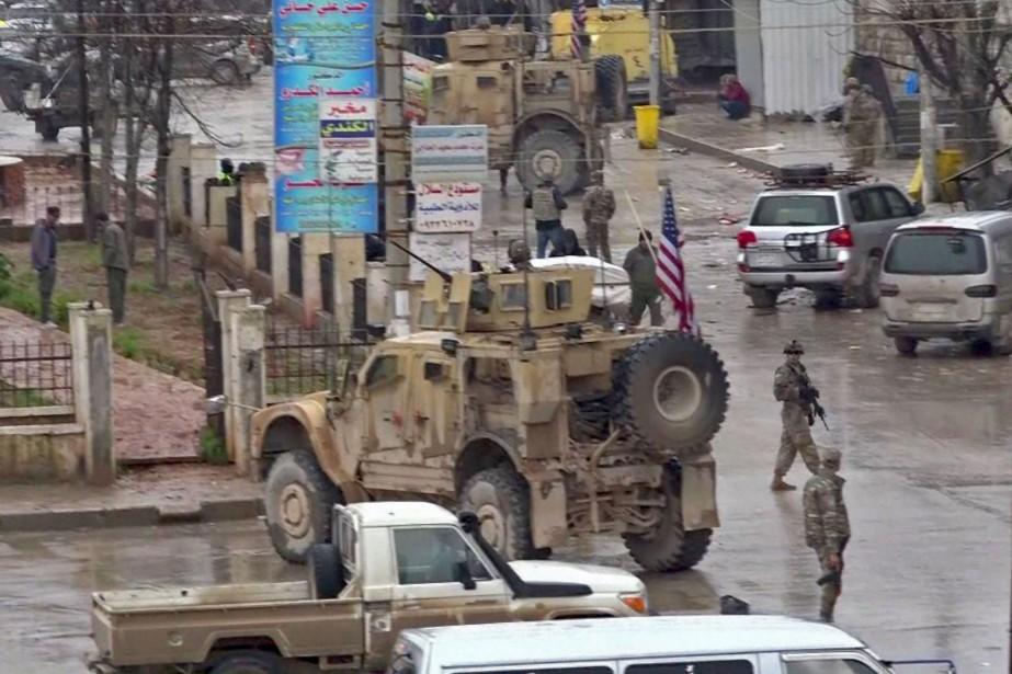 Des soldats américains sur le site d'un attentat... (Photo AFP)