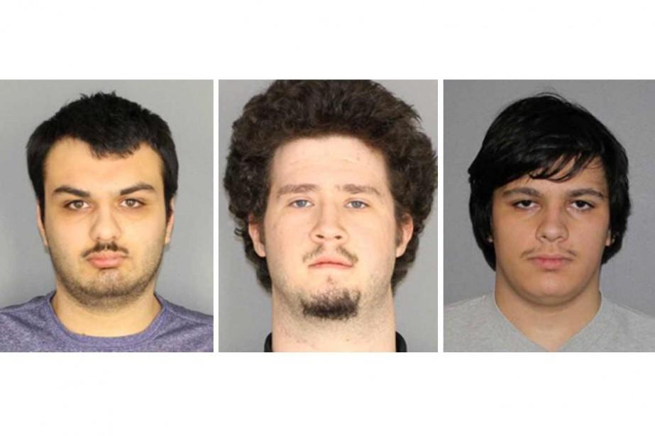 Les trois garçons majeurs arrêtés ont été identifiés... (PHOTO REUTERS)