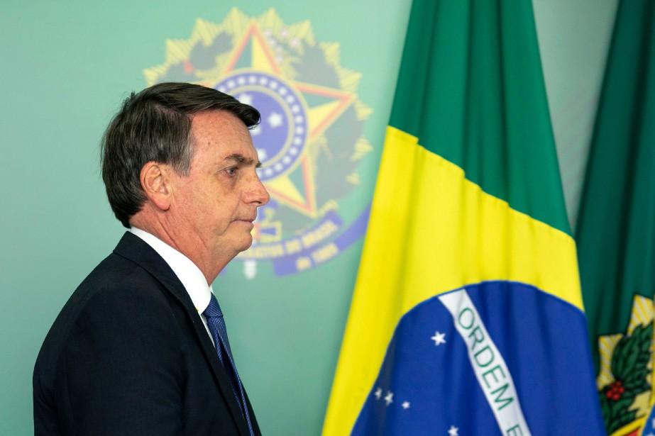 Le président brésilien Jair Bolsonaro... (Photo SERGIOLIMA, AFP)
