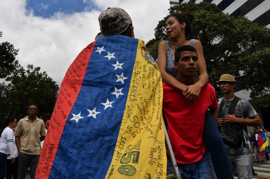 Le choix de défiler samedi n'est pas anodin:... (Photo YURI CORTEZ, AFP)