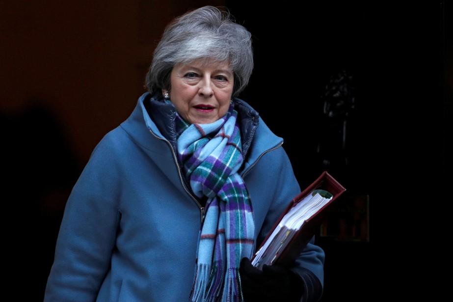 Theresa May a écarté la possibilité d'un report... (Photo Peter Nicholls, REUTERS)