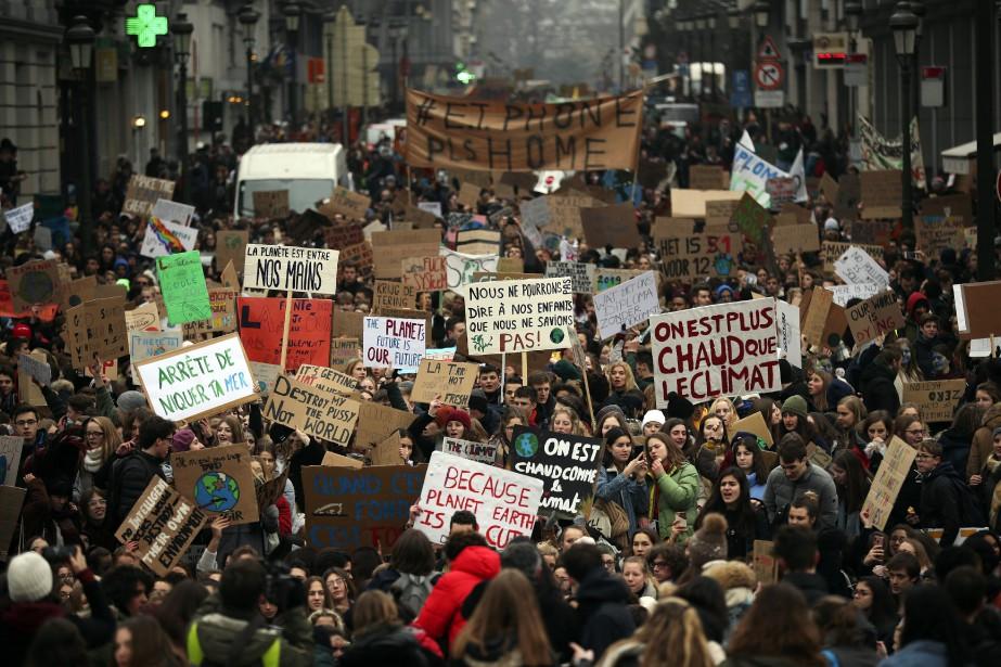 Une marche pour le climat a rassemblé quelque... (PHOTO AP)