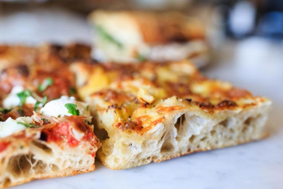 Pizza à la coupe du Club social P.... (Photo Edouard Plante-Fréchette, La Presse)