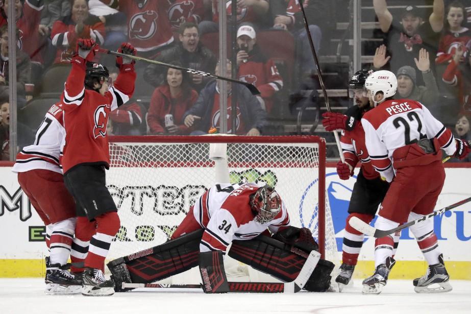 Marcus Johansson a enfilé l'aiguille à deux reprises et les Devils... (PHOTO AP)