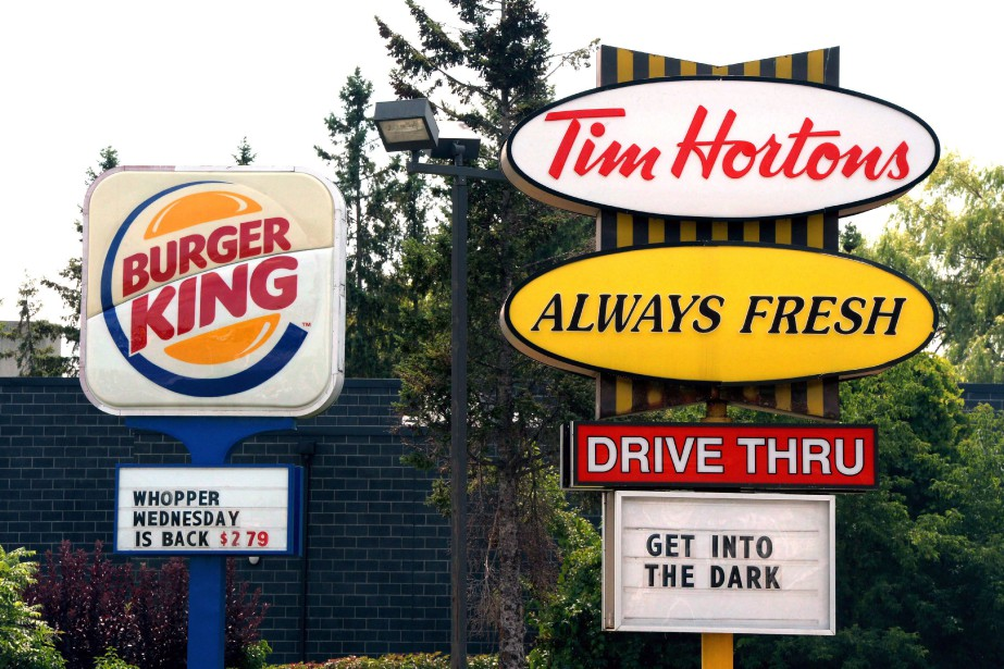 Burger King and Tim Hortons signs are displayed... (Photo Sean Kilpatrick, THE CANADIAN PRESS)