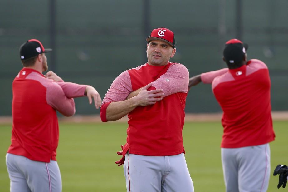 Joey Votto (au centre) a été limité à... (Photo Ross D. Franklin, Associated Press)