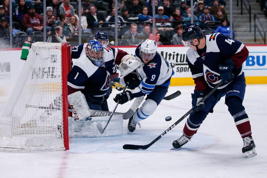 Andrew Copp (9) des Jets de Winnipeg ainsi... (Photo Isaiah J. Downing, USA TODAY Sports)