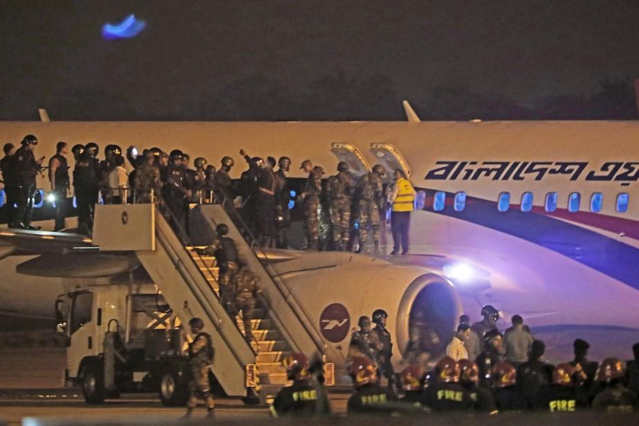 Les forces spéciales ont libéré dimanche soir sains... (Photo STR VIA AFP)