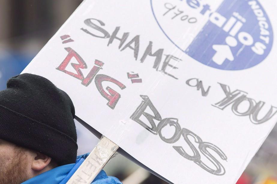 Une pancarte lors de la manifestation des syndiqués... (PHOTO GRAHAM HUGHES, ARCHIVES LA PRESSE CANADIENNE)