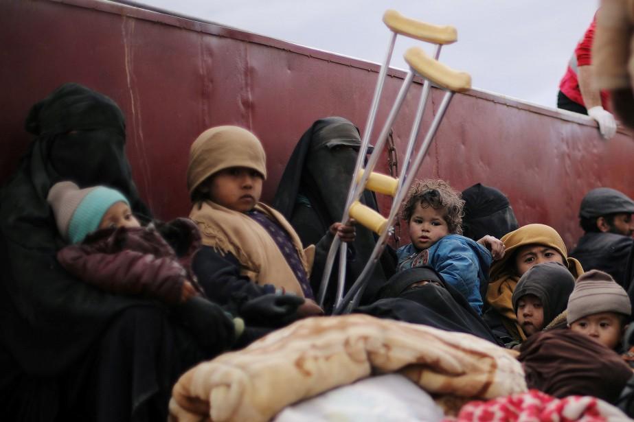 Plusieurs milliers de personnes - femmes et enfants... (PHOTO RODI SAID, ARCHIVES REUTERS)