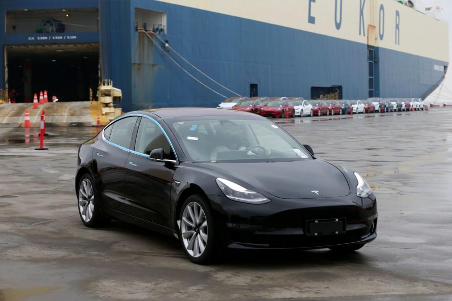 Un Modèle 3 de Tesla exporté en Chine,... (PHOTO CHINA STRINGER NETWORK, REUTERS)