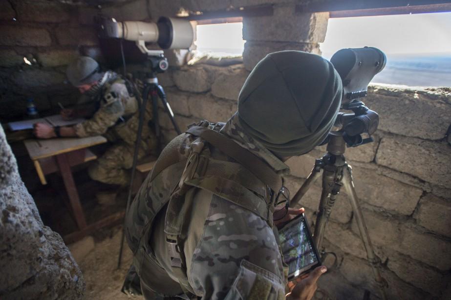 Des membres des forces spéciales canadiennes dans le... (PHOTO RYAN REMIORZ, ARCHIVES LA PRESSE CANADIENNE)