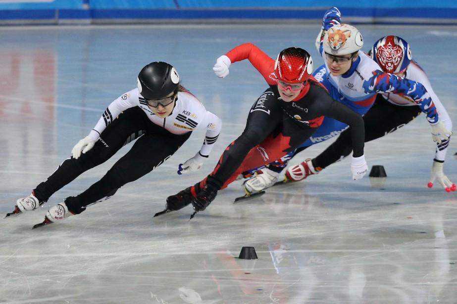 Kim Boutin (en rouge et noir) a terminé... (PHOTO STOYAN NENOV, REUTERS)