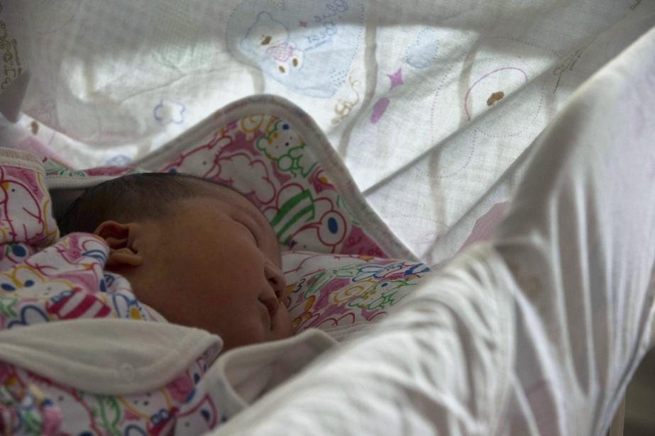 Les bébés nés de mères qui n'ont pas... (PHOTO NG HAN GUAN, ASSOCIATED PRESS)