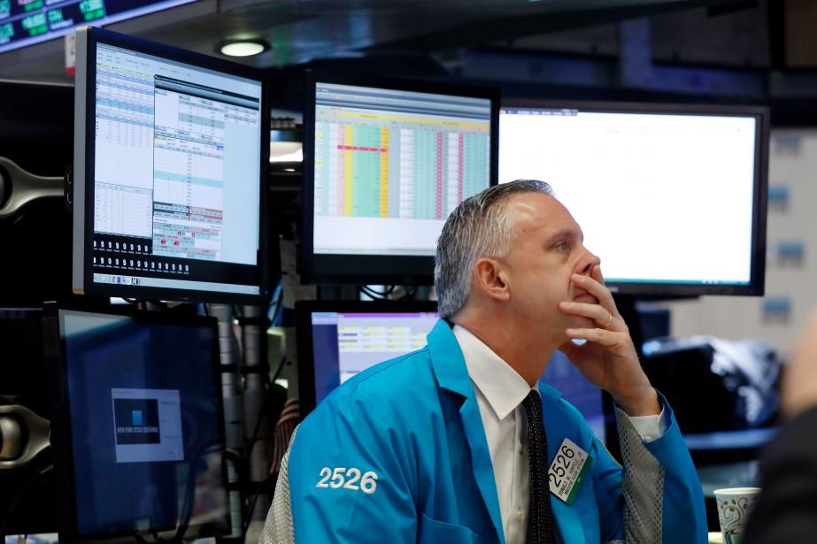 Le Dow Jones perdait 0,04% et le NASDAQ... (PHOTO RICHARD DREW, AP)