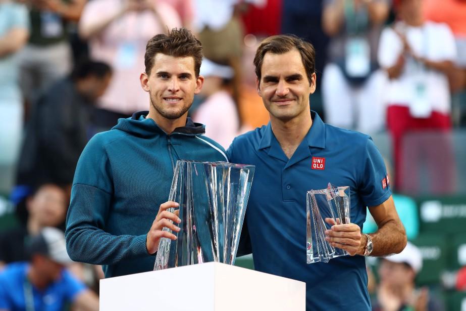 Dominic Thiem (à gauche) a défait Roger Federer... (PHOTO CLIVE BRUNSKILL, AGENCE FRANCE-PRESSE)